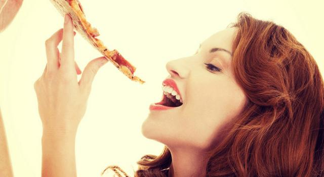 Woman eating a biscuit