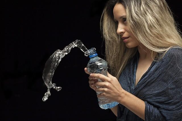 a girl drinking water image