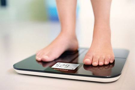 Person stepping on a body fat analyzer