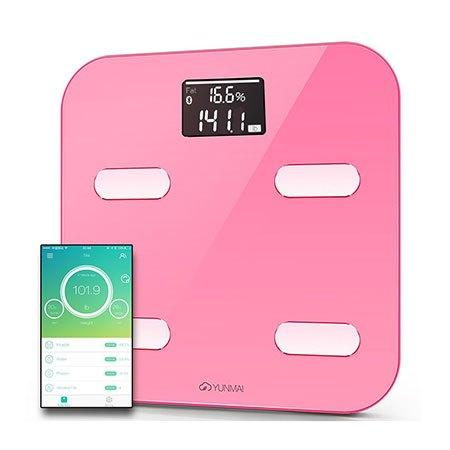 Yunmai smart color scale next to a smartphone