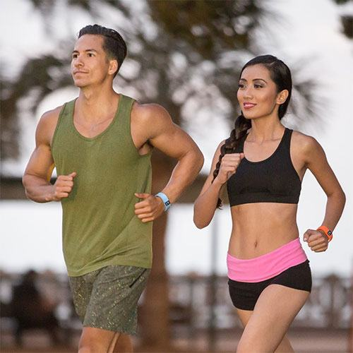 Two people running with an activity tracker on their wrist