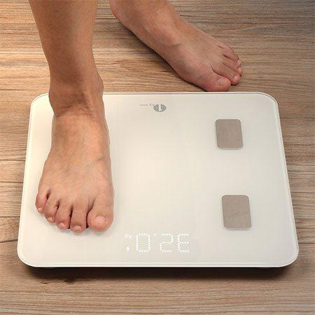 Someone stepping on the 1Byone body fat analyzer