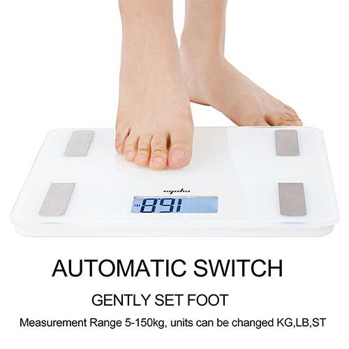 Bare feet stepping on a scale