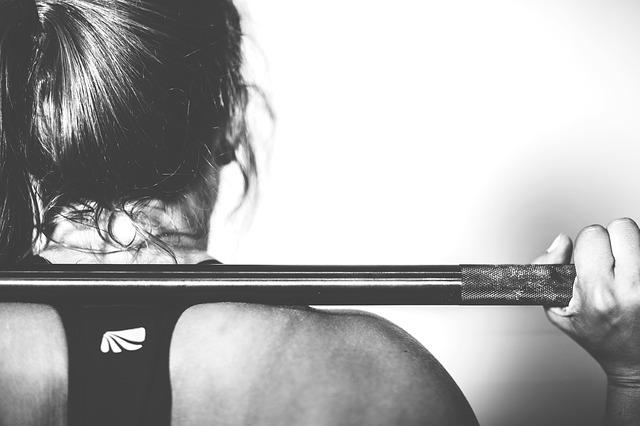 Woman with a barbell on her back